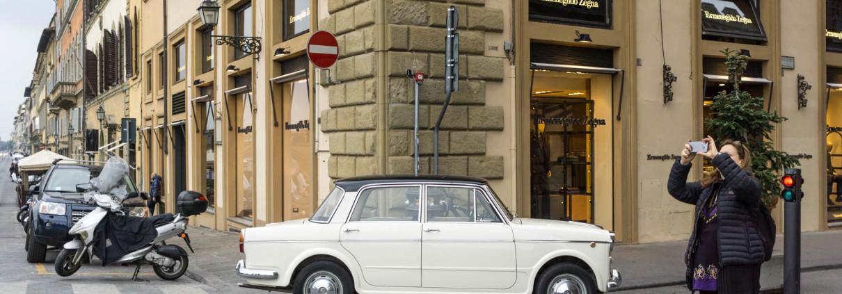 Elegant vintage Fiat on Via dé Tornabuoni, Florence